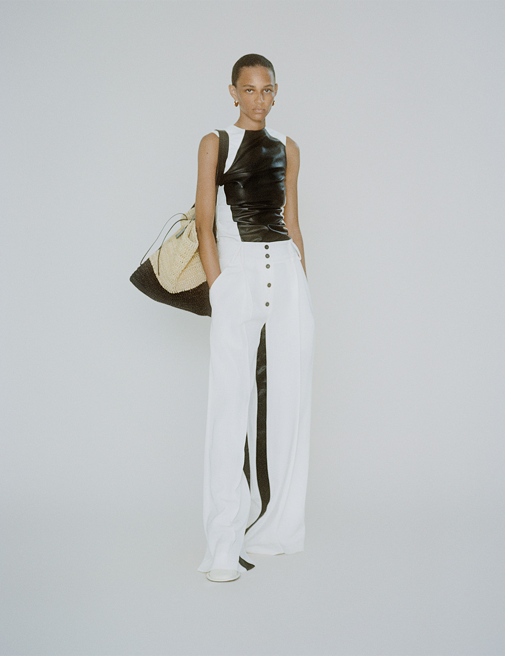 SS21 Look 13: Black and White leather top and cotton pants