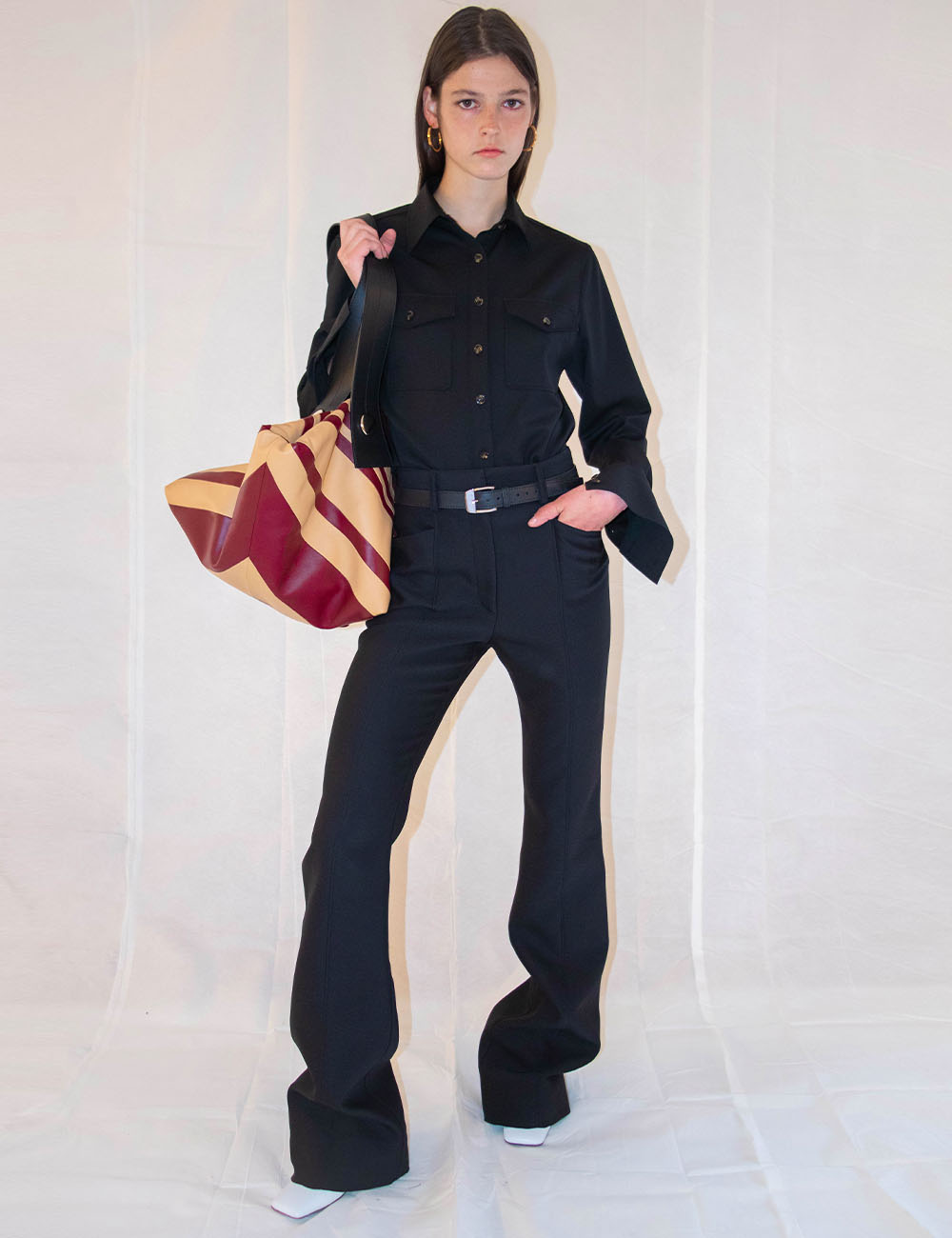 Black shirt and black pants with striped puffy tote